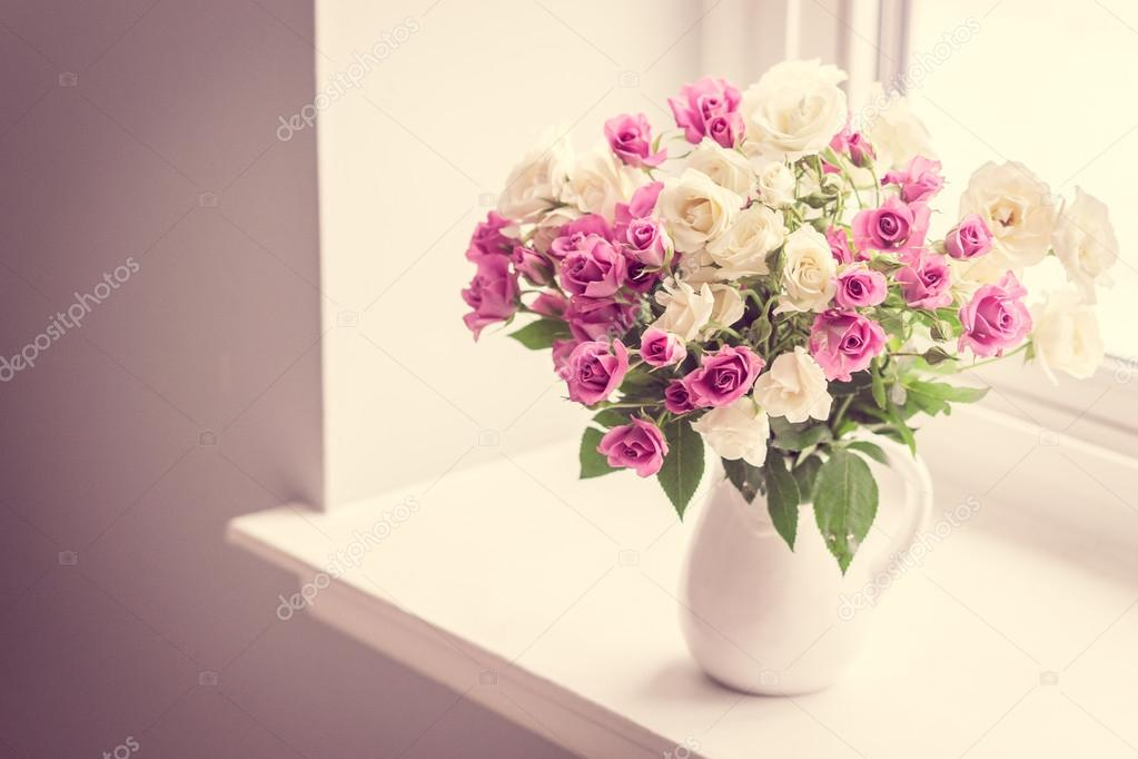 depositphotos 67057563-stock-photo-roses-in-a-vase